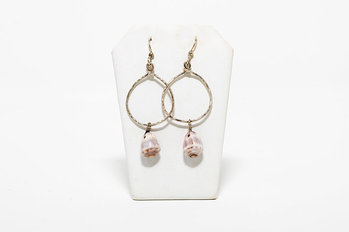 Hand-hammered sterling silver hoop earrings with cone shell charms handmade in Maui, Hawaii