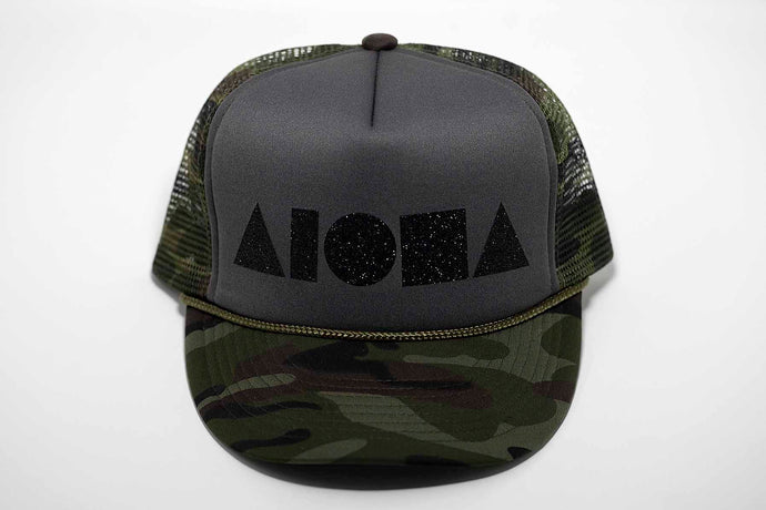 Aloha Shapes® logo printed in black sparkles on a camo green adult trucker hat