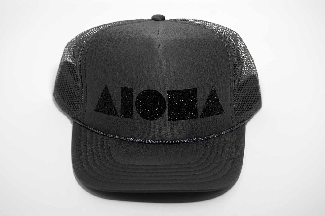 Aloha Shapes printed in black sparkles on grey adult trucker hat