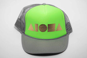 Aloha Shapes logo foil printed in gold on a neon green and grey adult trucker hat