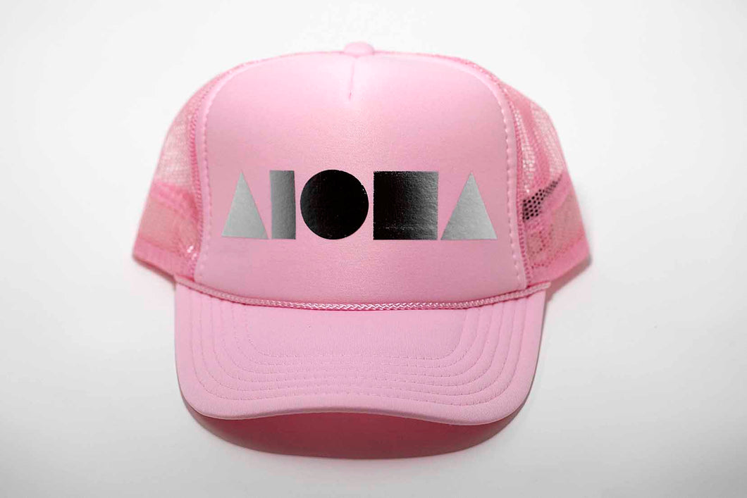 Aloha Shapes ® logo foil printed in metallic silver on a pink adult trucker hat