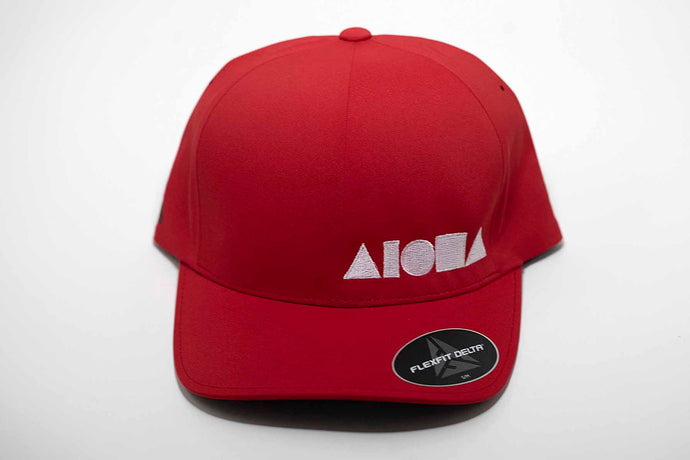 Aloha Shapes ® logo embroidered in white on a red adult Flexfit hat