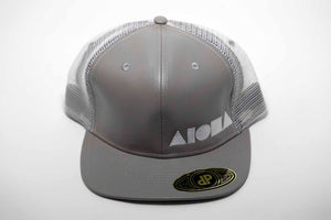 Faux grey leather adult flat brim snapback embroidered with Aloha Shapes ® logo