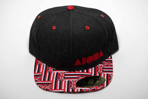 Hawaiian flag interlock pattern on flat brim with black denim snapback panels embroidered with red Aloha Shapes ® logo