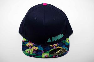 Adult flat brim snapback hat embroidered with turquoise Aloha Shapes ® logo on black hat with tropical orchid flower fabric on brim