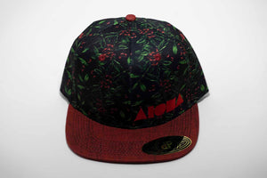 Adult flat brim snapback hat with coffee bean plant printed on black fabric. Red denim brim. Embroidered with red Aloha Shapes ® logo