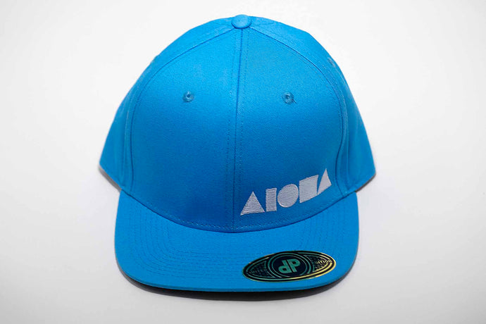 Sky blue adult flat brim snapback hat embroidered with white Aloha Shapes ® logo