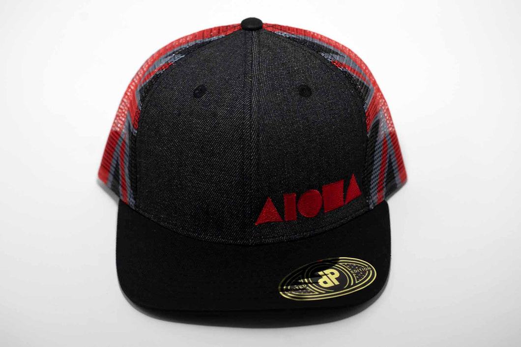 Adult flat brim snapback hat with black, red and grey Hawaiian flag printed on back mesh panels. Front panels are black denim embroidered with red Aloha Shapes ® logo