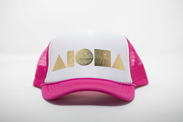 Pink and white youth trucker hat foil printed with gold Aloha Shapes ® logo