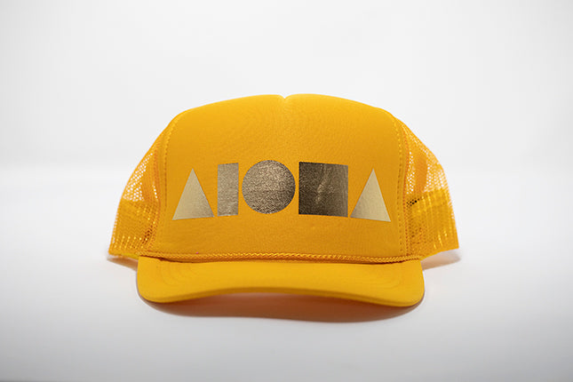 Yellow foam youth trucker hat foil printed with metallic gold Aloha Shapes ® logo