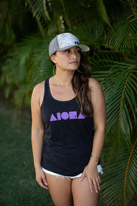 Girl wearing Aloha shapes® racerback tank and a curved bill baseball hat