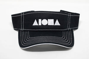 Black canvas visor cap accented with white striped stitching. Embroidered in Maui with white Aloha Shapes ® logo