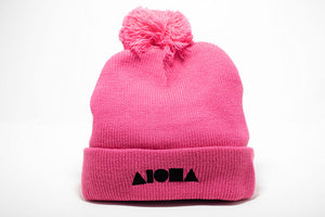 Pink acrylic beanie cap embroidered with black Aloha Shapes ® logo