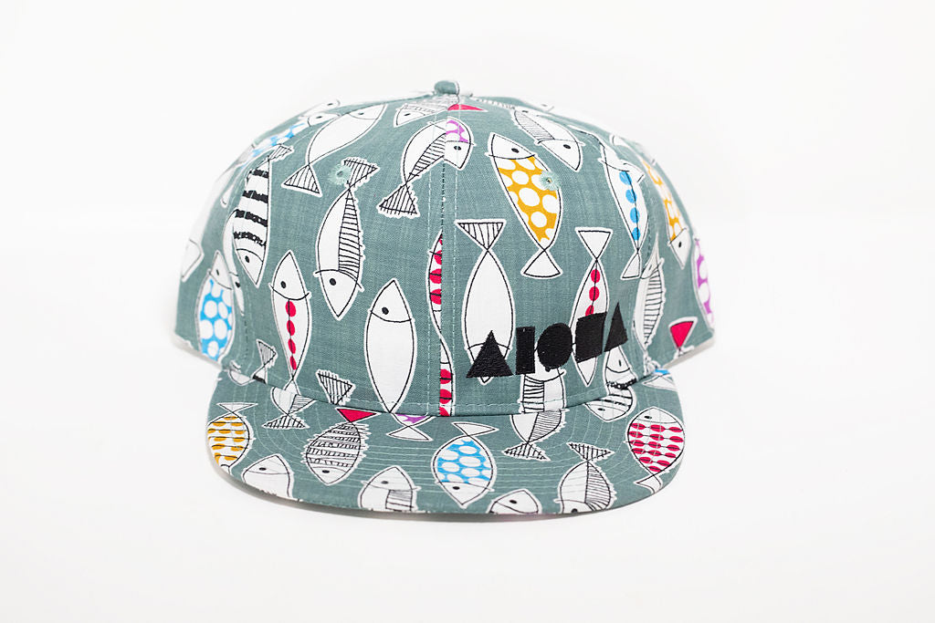 Doodled fish pattern fabric with black embroidered Aloha Shapes ® logo adult flat brim snapback hat