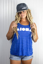 Woman with blond dreadlocks in a blue Aloha Shapes® tank top wearingAdult flat brim snapback hat with Grey tribal print foam front panels embroidered with white Aloha Shapes logo. Grey mesh back panels.
