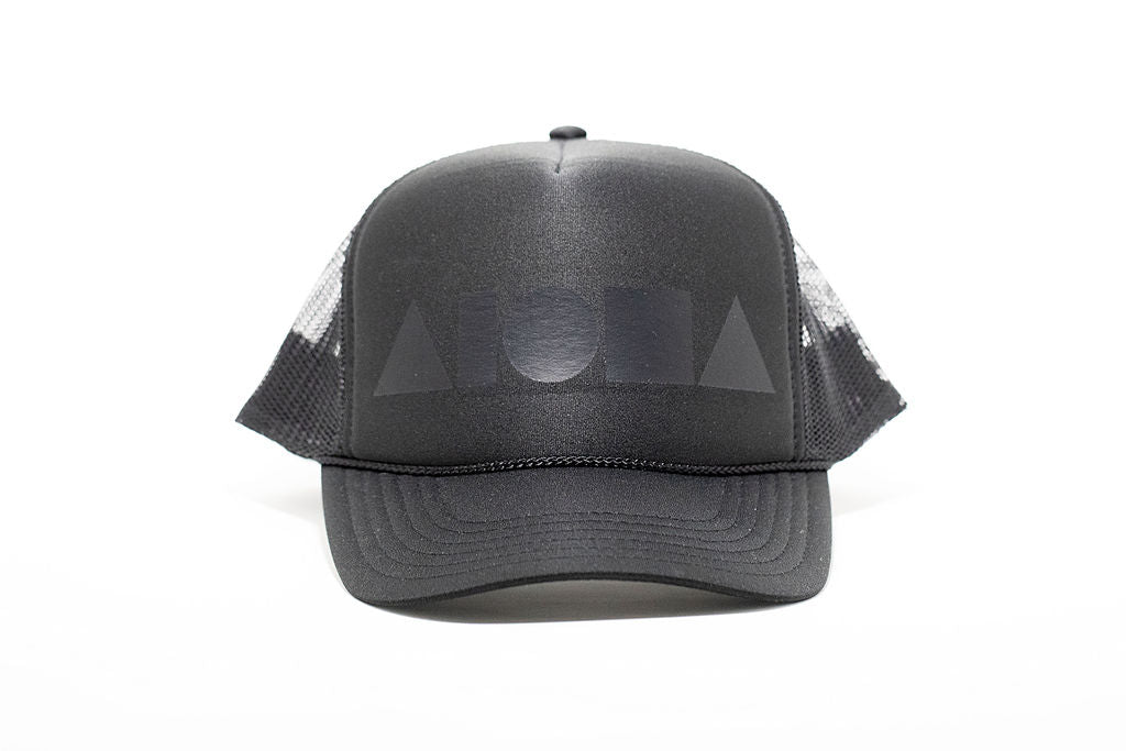 Black adult trucker hat printed with matte black Aloha Shapes® logo. Designed in Maui, Hawaii