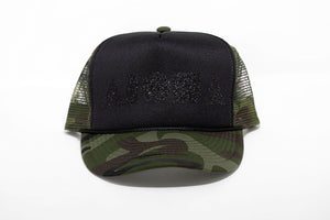 Camo print adult foam trucker hat foil printed with black sparkle Aloha Shapes logo