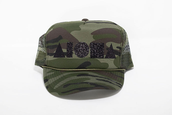 Camouflage print adult trucker hat with Aloha Shapes logo printed in metallic black sparkle print