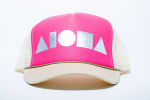 Adult trucker hat with cream brim and back panels, neon pink front panels and metallic silver foil print Aloha Shapes logo
