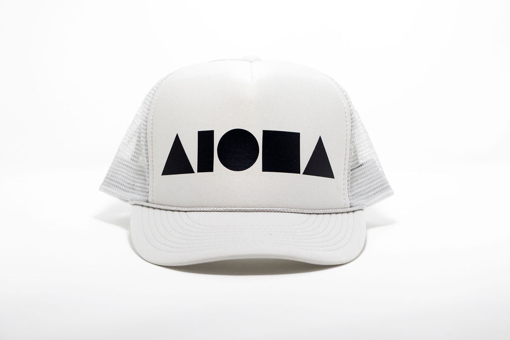 Light grey adult trucker hat printed with matte black Aloha Shapes® logo. Designed in Maui, Hawaii