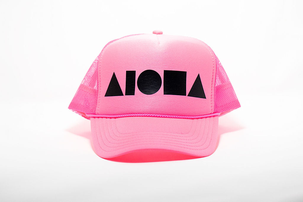 Neon pink adult trucker hat printed with matte black Aloha Shapes® logo. Designed in Maui, Hawaii