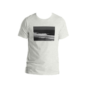 Ash grey unisex T-shirt printed on the front with a black and white photo by Stu Soley of the waves at Uluwatu, Bali