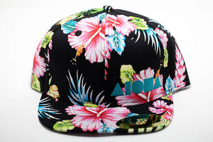 Tropical floral print adult flat brim snapback hat embroidered in Maui Hawaii with blue aloha shapes logo