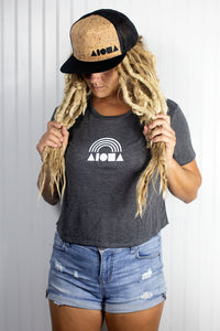 Blond dreadlocked girl wearing an Aloha Shapes ® rainbow crop top