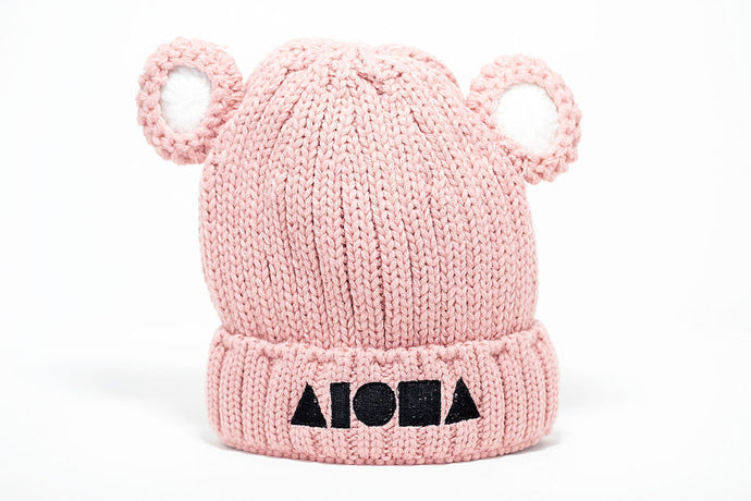 Pink knitted youth beanie with crocheted bear ears. Embroidered with Aloha Shapes® logo