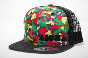 Adult flat brim snapback hat. Black denim brim. Red/yellow/green camo print on front panels made up of repeated silhouettes of Hawaiian island chain. Black mesh back panels. Embroidered with black ALOHA Shapes ® logo