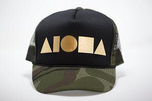 Adult foam trucker hat. Military green camo brim. Black foam front panels with gold foil print Aloha Shapes® logo. Military green mesh back panels.