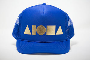 Adult foam trucker hat. Royal blue brim and front foam panel foil printed with gold ALOHA Shapes ® logo. Royal blue mesh back panels.