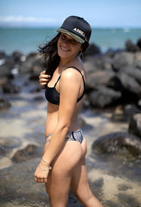 "Woman on beach in bikini on Maui, Hawaii wearing ""Camo Cush"" Adult snapback"