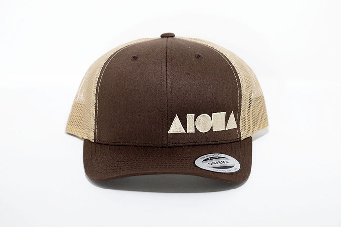 Adult curved bill snapback hat. Brown bill and front panels. Tan color mesh back panels. Embroidered with tan ALOHA Shapes ® logo
