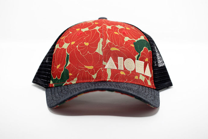 Adult curved bill snapback with anthurium flower printed fabric on front panels. Black mesh back panels