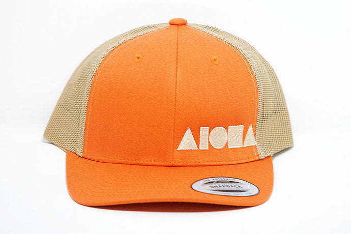 Orange and tan curved bill adult snapback hat embroidered with tan Aloha Shapes logo