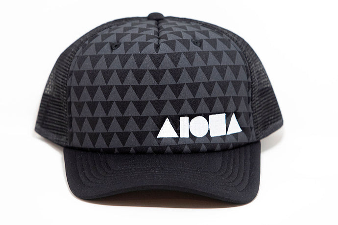 Black curved bill adult snapback hat with grey and black triangle pattern on front panels. Embroidered with white Aloha Shapes® logo