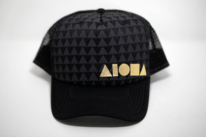 Black curved bill adult snapback hat with grey and black triangle pattern on front panels. Foil printed with metallic gold Aloha Shapes® logo