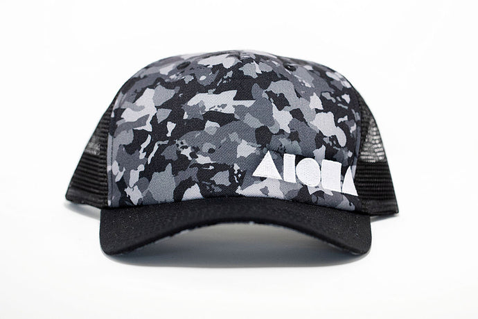 Greyscale Hawaiian islands camo on a black curved bill mesh back adult snapback hat