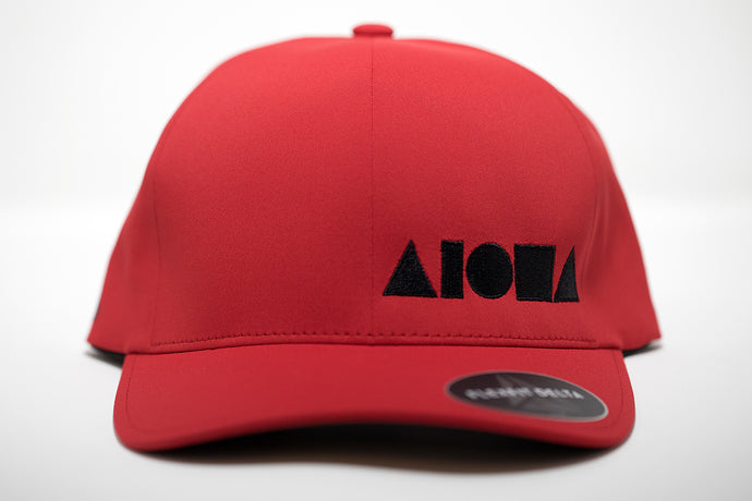 Adult Flexfit hat. Red waterproof material embroidered with black ALOHA Shapes ® logo