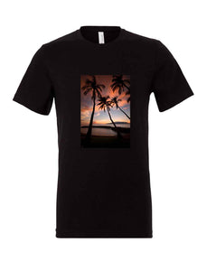 Black unisex short sleeve t-shirt with a photo of palm trees and sunset printed on the front chest. Limited edition series of 50. Photo by Stu Soley.