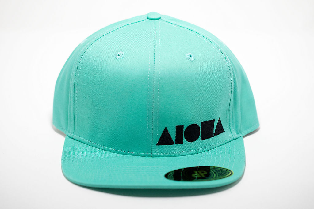Cyan colored adult flat brim snapback hat embroidered with black Aloha Shapes ® logo