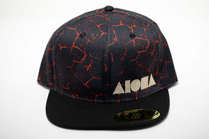 Red and black lava print fabric adult flat brim snapback hat embroidered with gold Aloha Shapes ® logo