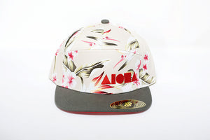 Adult flat brim seven-panel snapback hat with floral print and red Aloha Shapes logo
