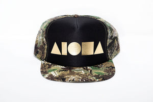 camo print Adult flat brim snapback with foam front panels and gold foil printed Aloha Shapes logo