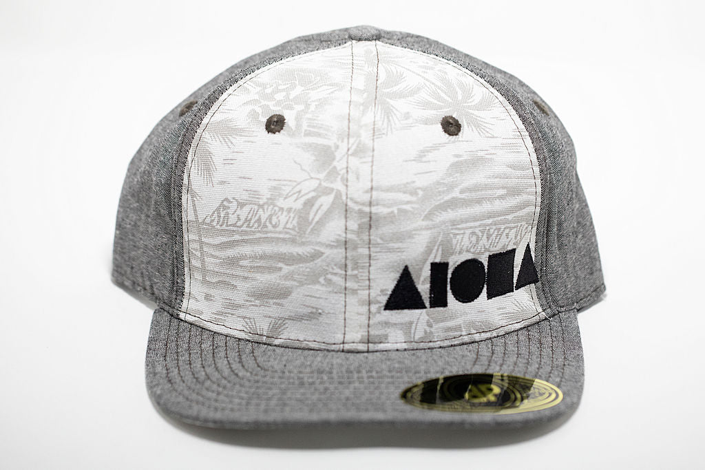 Grey denim and white tropical fabric adult flat brim snapback hat embroidered with black Aloha Shapes ® logo