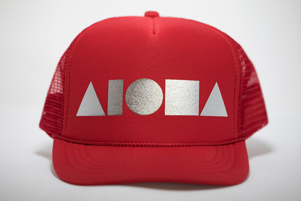 Youth foam trucker hat. Red brim and foam front panel foil printed with silver ALOHA Shapes ® logo. Red mesh back panels.