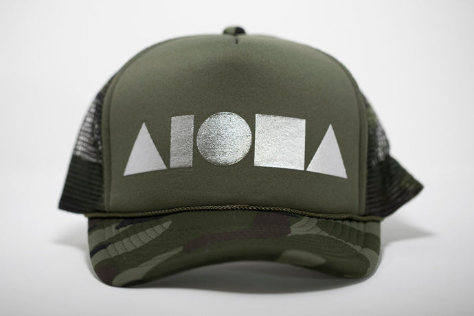 Adult foam trucker hat. Military green camo brim. Military green foam front panels with silver foil print Aloha Shapes® logo. Military green mesh back panels.