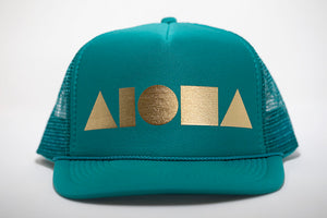 Adult foam trucker hat. Jade brim and front foam panel. Gold foil print ALOHA Shapes ® logo. Jade mesh back panels.