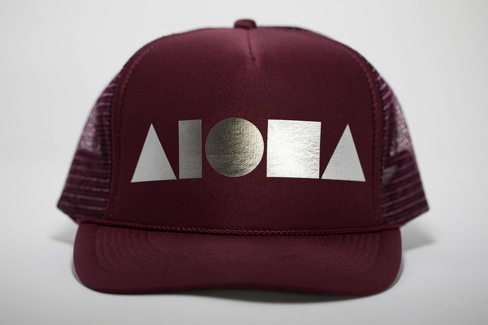 Adult foam trucker hat. Maroon brim and foam front panel foil printed with silver ALOHA Shapes ® logo. Maroon mesh back panels.